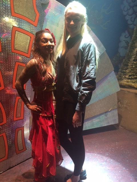 Jess on stage with Jade Ellis during Aladdin 2014